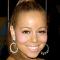 Jest da Mariah Carrey ima lijep osmjeh no je li baš posebno morala naglasiti te ružičaste obraščiće?
